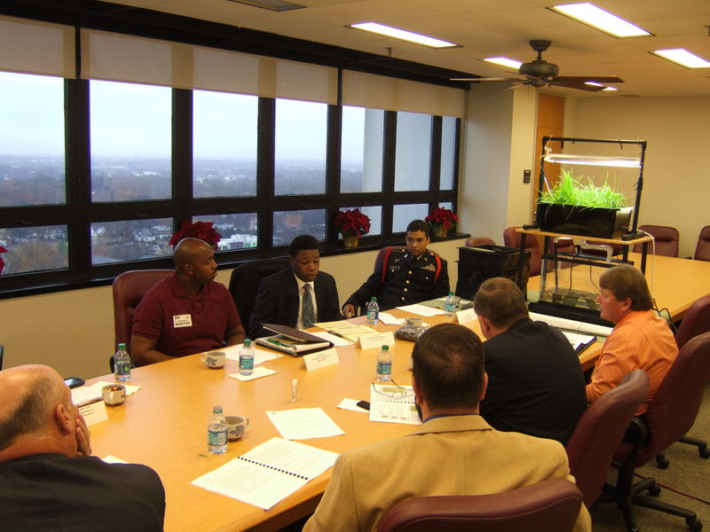 Veteran coordinator Davon Goodwin, and youth leaders Cody Oxendine and Terrence Smith lead a presentation for the Department of Public Safety's Executive Leadership Team on Dec 9, 2013.,