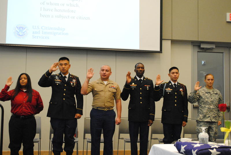 Six active duty and former servicemen and women became U.S. citizens during a Veteran's Day ceremony at the Durham County Health and Human Services building. Webton Webley is third from the right in this picture.