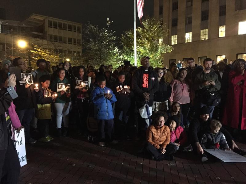 """Hundreds gathered in downtown Durham on Tuesday night to protest the lack of charges against Darren Wilson. They held signs that read """"We Are All Michael Brown."""""""