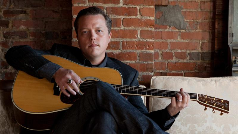 A picture of Jason Isbell with a guitar.