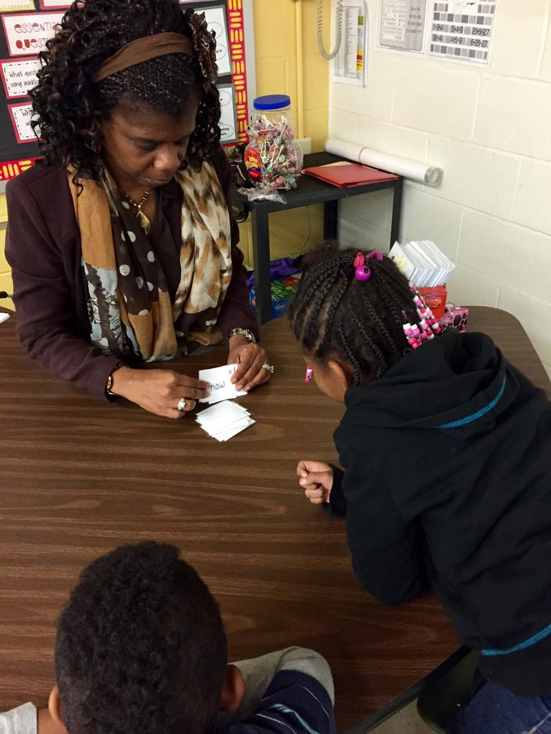 Fayetteville teacher assistant Grace King works with first graders on sight words.