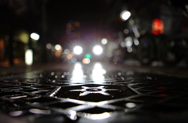 A manhole cover at night