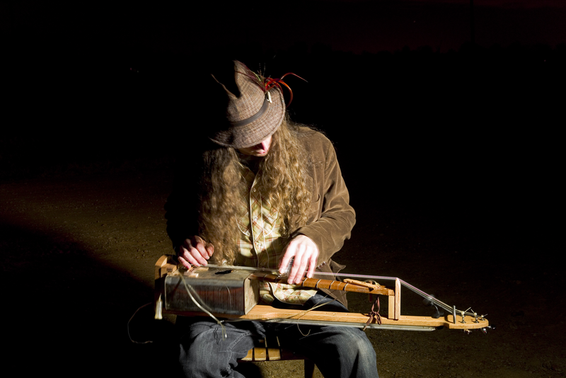 Justin Johnson playing cigar box guitar