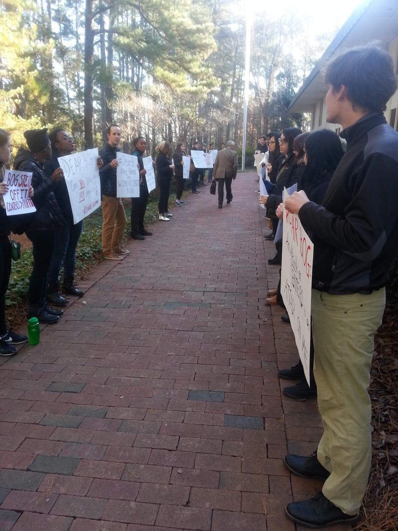 Protesters lined a walk way at UNC-Chapel Hill, before a Board of Governors work group convened.