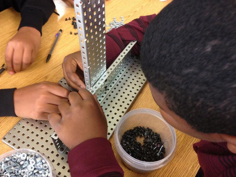 Students in Neal Magnet Middle's STEM Academy building robots.