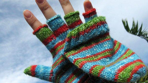A picture of a hand in a fingerless glove.