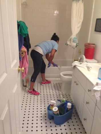 The Housecleaner Project from Duke University documents the daily lives of women who earn their livings as housecleaners. A woman featured here cleans a bathroom in a Durham house.