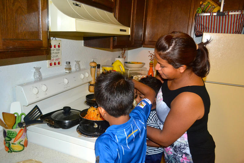 Lilia, a Durham housecleaner, makes breakfast with her son.