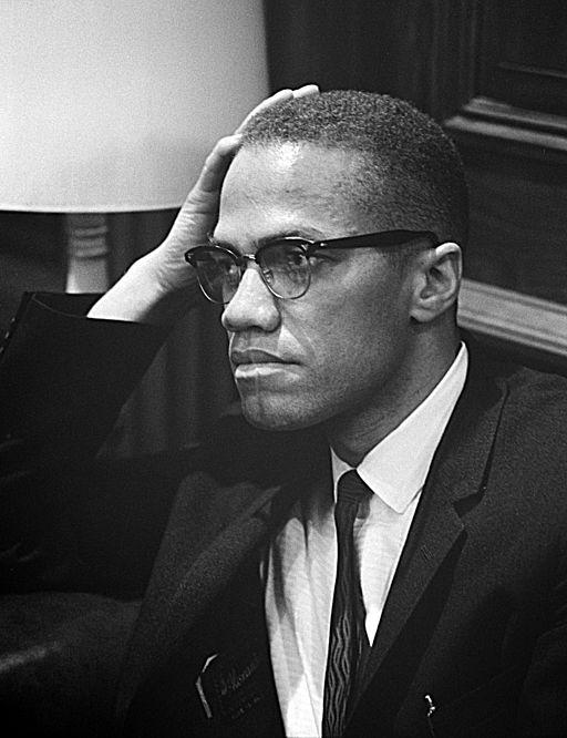 Malcolm X waiting for a press conference to begin on March 26, 1964.