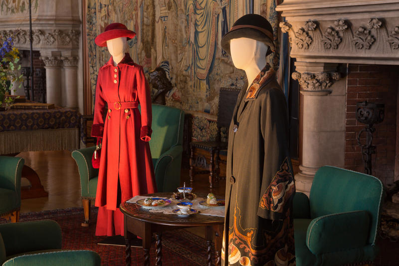Set in the Tapestry Gallery is Lady Mary's wool coat (L) worn trimmed in velvet. On the right is a coat worn by Lady Edith Crawley. Tailored clothes for women were worn for travel or sporting activities from the late 19th century onward.