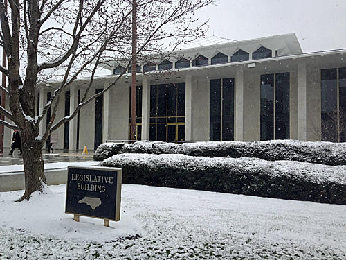 snow at the General Assembly building, Raleigh
