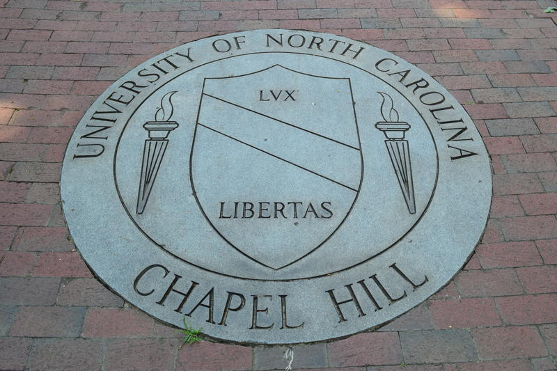 A representation of the university seal, located in front of South Building. Dedicated by the class of 1989, it marks UNC's exact geographic location.