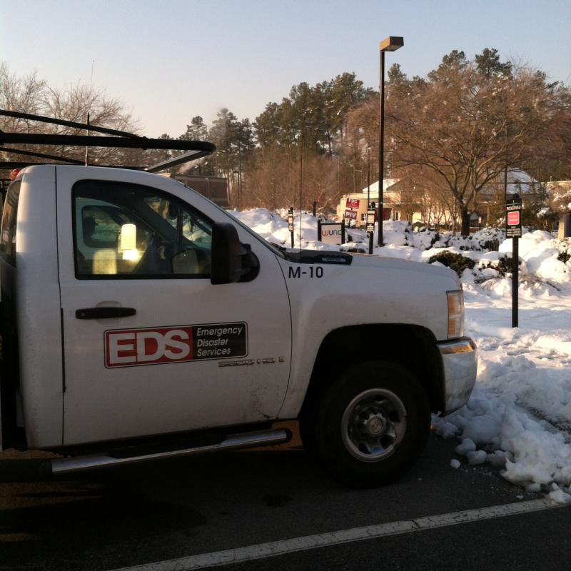 A picture of an EDS truck by the WUNC sign.