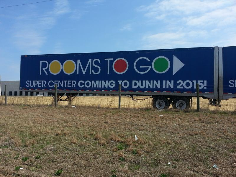 A Rooms To Go billboard.