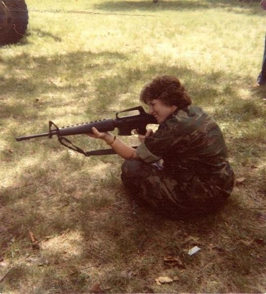CJ demonstrates the sitting position when firing an M16. She was in the first platoon of women Marines to receive combat training in 1981.