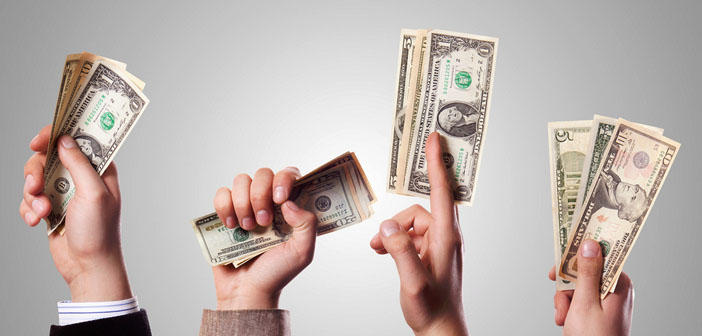 A picture of hands holding cash.