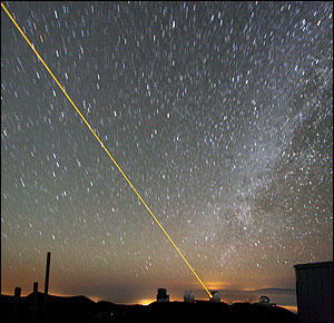 A laser beam is projected from the Keck II telescope in Hawaii.