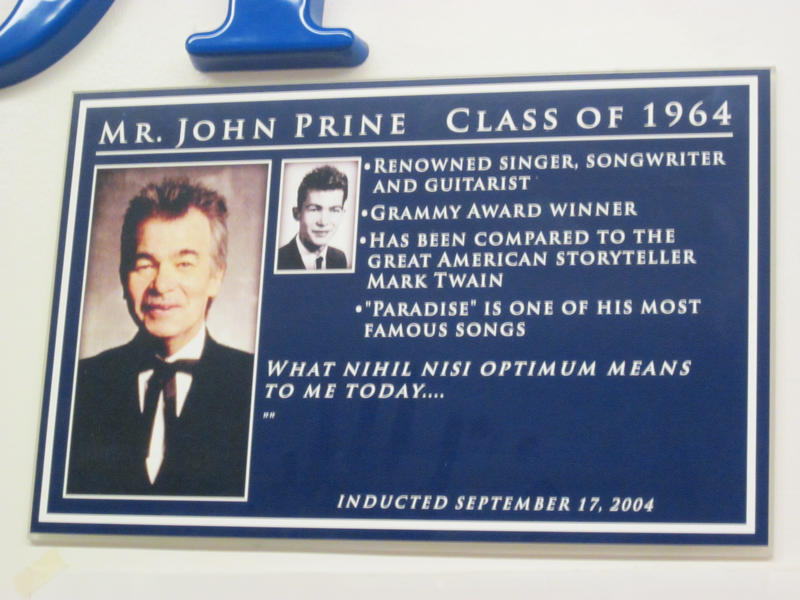 Photo of plaque at John Prine's high school that honors him.