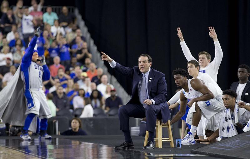 A picture of Coach K with team on sidelines.