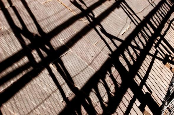 A picture of a shadow of scaffolding.