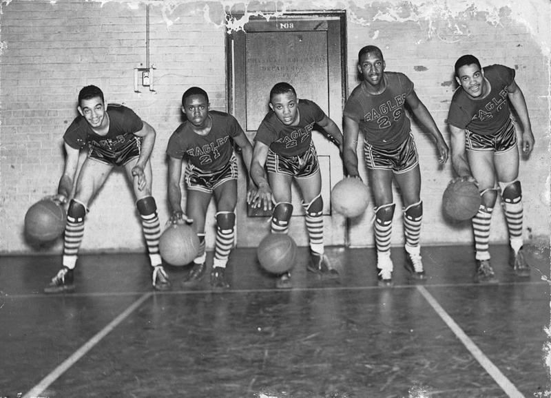 "North Carolina College Eagles, 1943-1944, from left to right: George Parks, Aubrey Stanley, James ""Boogie"" Hardy, Floyd Brown, Henry ""Big Dog"" Thomas."