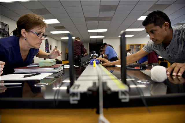Student and teachers work in a physics lab at Central Piedmont Community College. Many first-generation students are low-income, and community colleges are the most affordable option for working towards a degree.