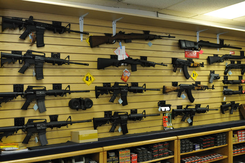 Gun wall featuring rifles and assault riffles.