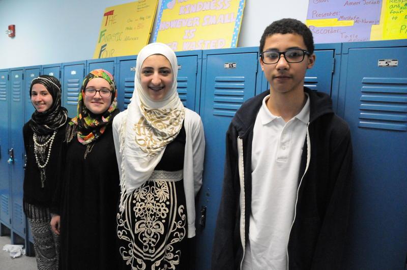 Eighth-grade students Yasmine Boufedji, Angelycia Bogart, Dunya Alkaissi, and Nassir Jordan.