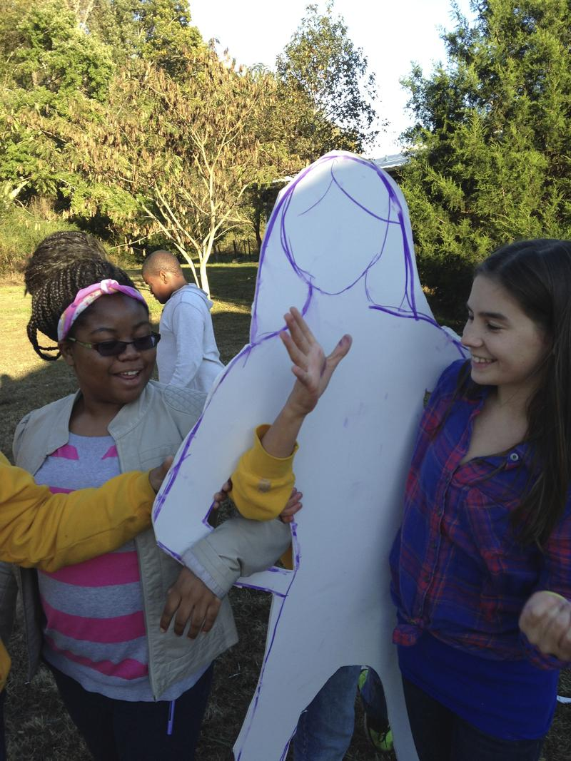 The John Hope Franklin Young Scholars created cut-outs of their characters to help with the writing process.