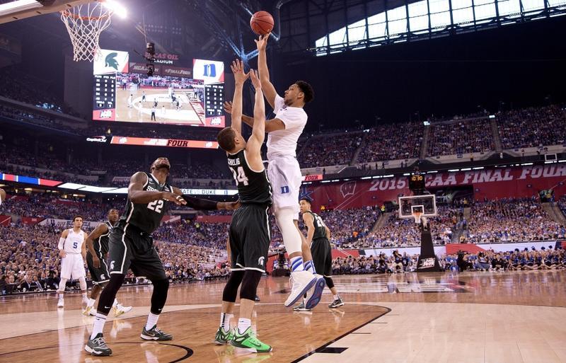 Duke's Jahlil Okafor takes a shot on Michigan State.