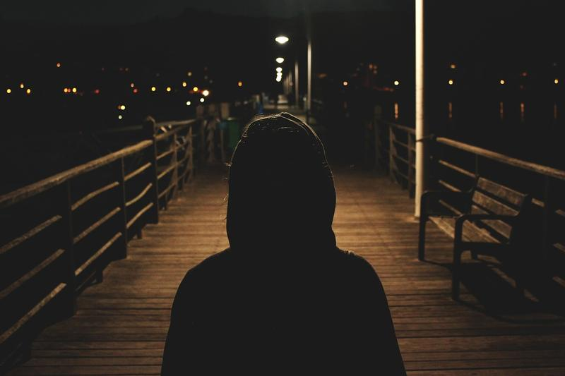 Image of shadowed figure with hood