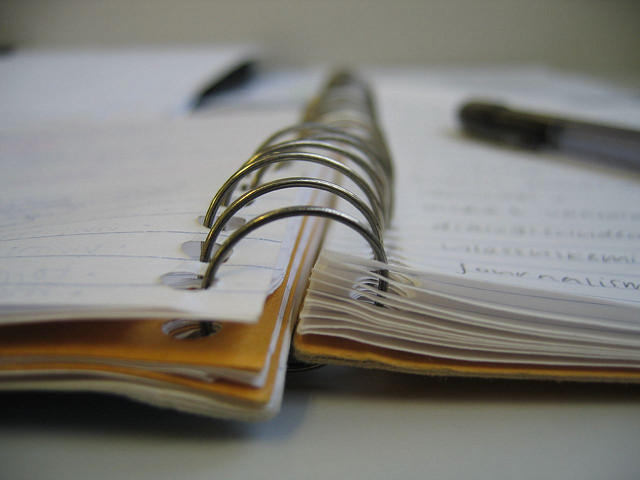 A picture of a spiral bound notebook.