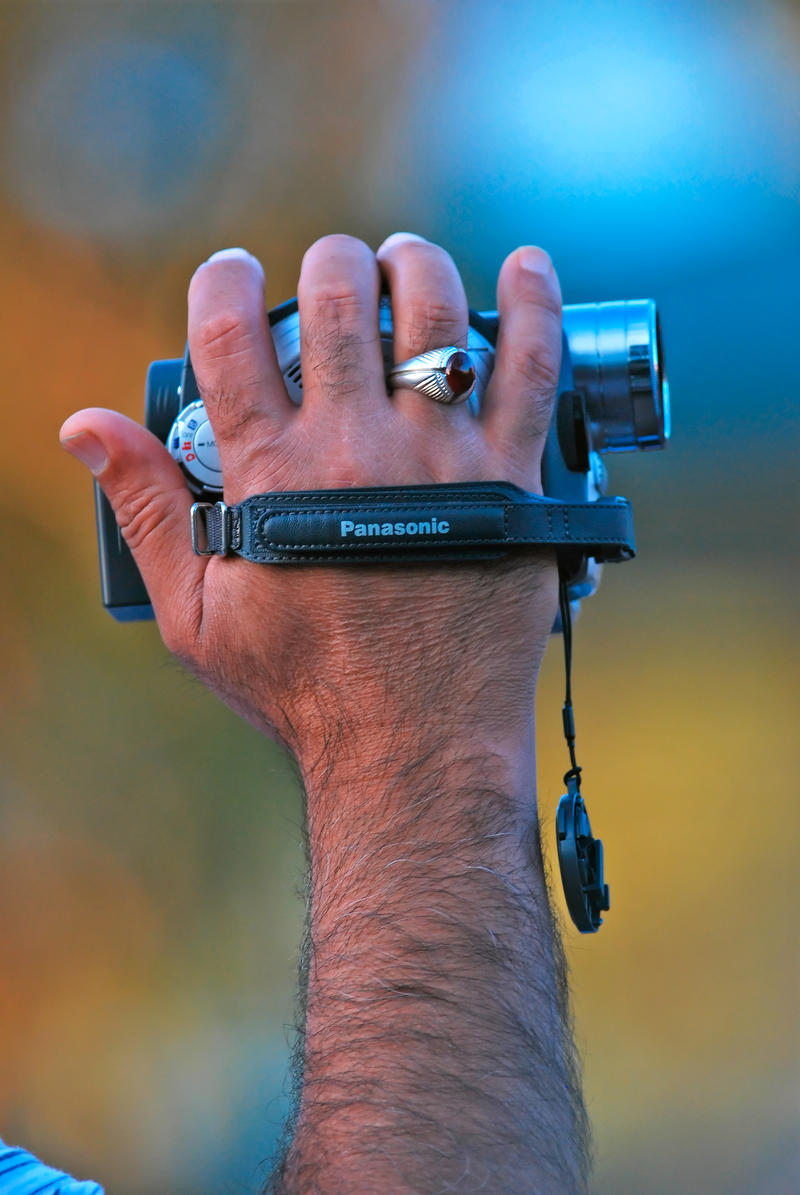 A picture of a hand holding a camcorder.