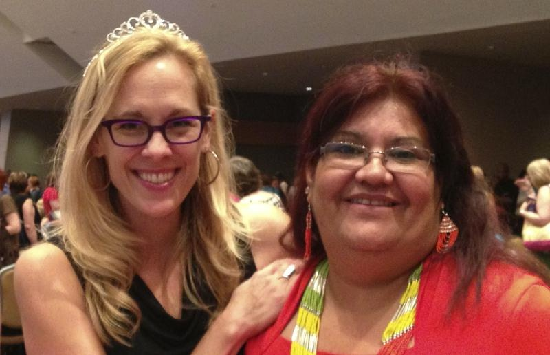 Image of author Katharine Ashe with a fan at a romance convention.