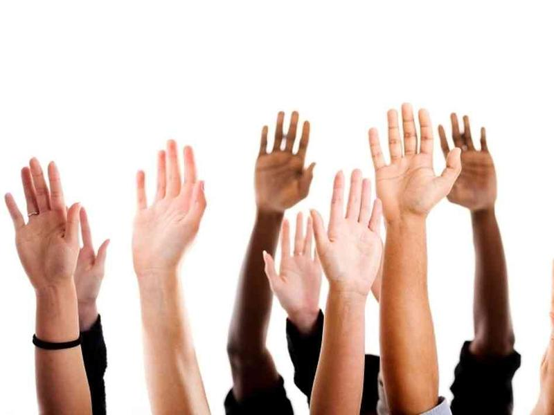 An image of hands raised
