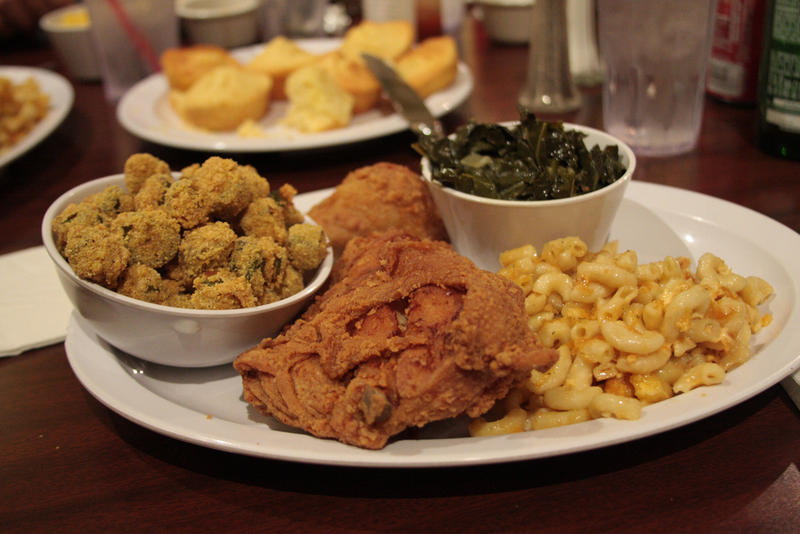 Image of a plate of soul food, including fried chicken, mac and cheese, collards, and fried okra.