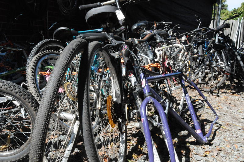 A picture of the stockyard of donated bikes.