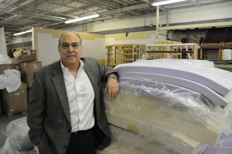 A picture of Bob Savino and some fresh mattresses.