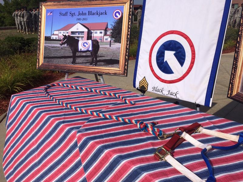 Staff Sgt. John Blackjack's photo and halter are displayed at a Ft. Bragg Memorial Service. The miniature mule died last month after serving more than three decades as the mascot for an Army supply unit.