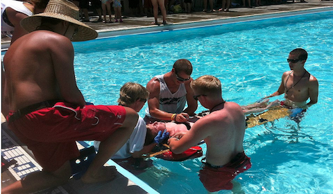 A picture of lifeguards training in a pool.
