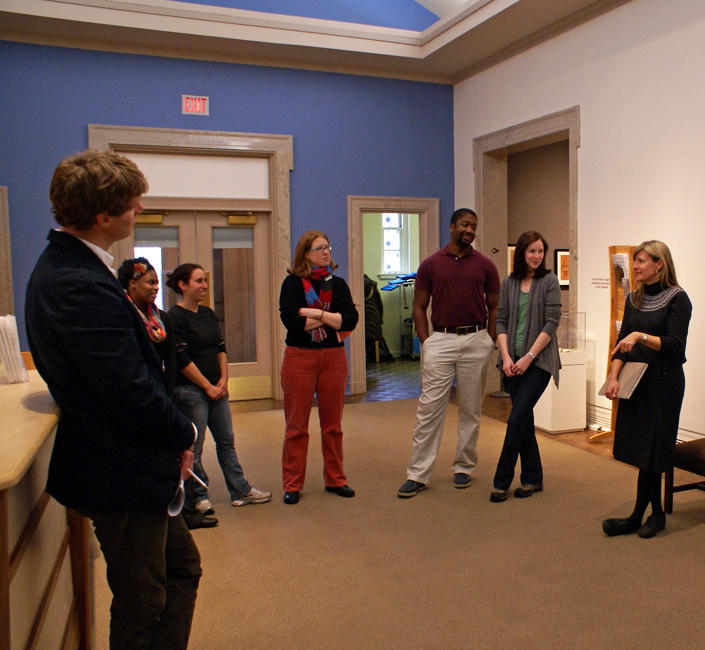 Image of Chapman talking to students in the lobby of the Ackland Art Museum.