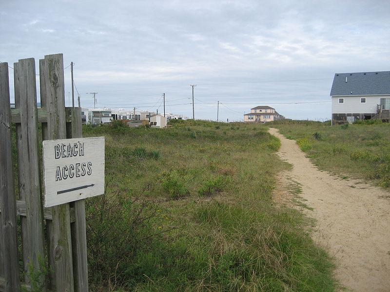 An image of a beach access sign