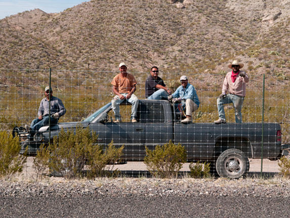 Image of men in truck along US/Mexico Boarder.