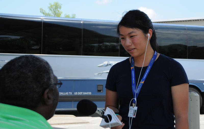 Samantha Lanevi interviews a Durham resident at a nearby bus station.