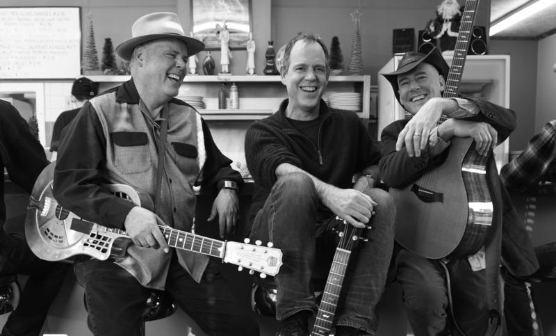 Image of the Three Davids laughing. The Three Davids' first concert sold out in Asheville, and they will play their second concert in Cary.