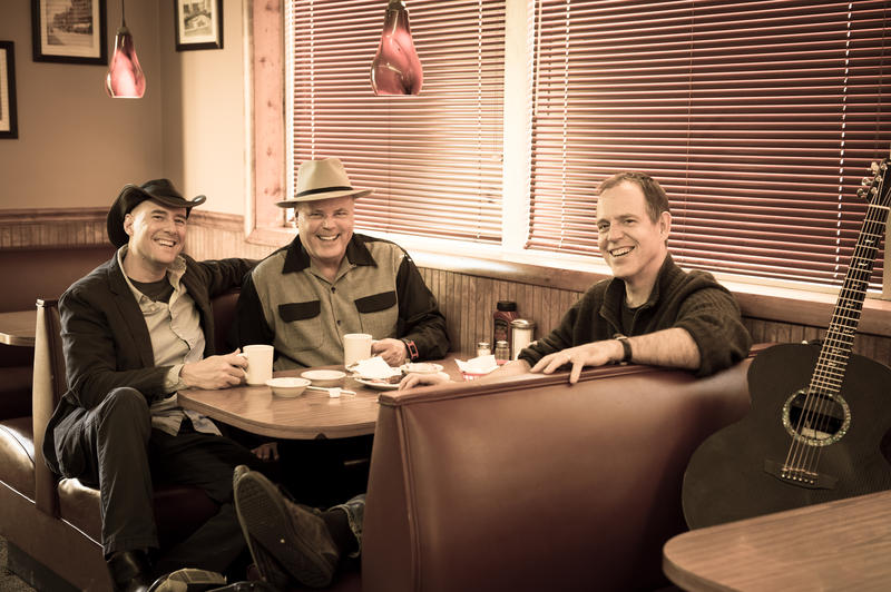 Image of the Three Davids sitting together. The Three Davids are a new musical collaboration between Asheville musicians David Holt, David LaMotte and David Wilcox.