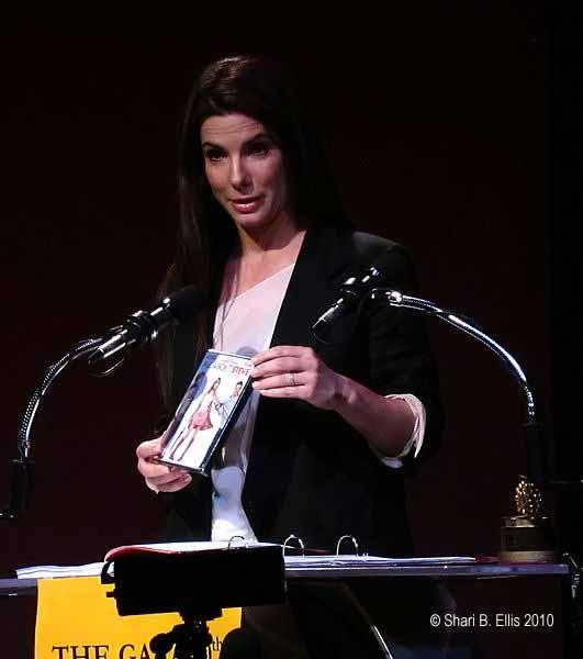 Image of Sandra Bullock accepting a Golden Raspberry award in 2010 for worst actress.