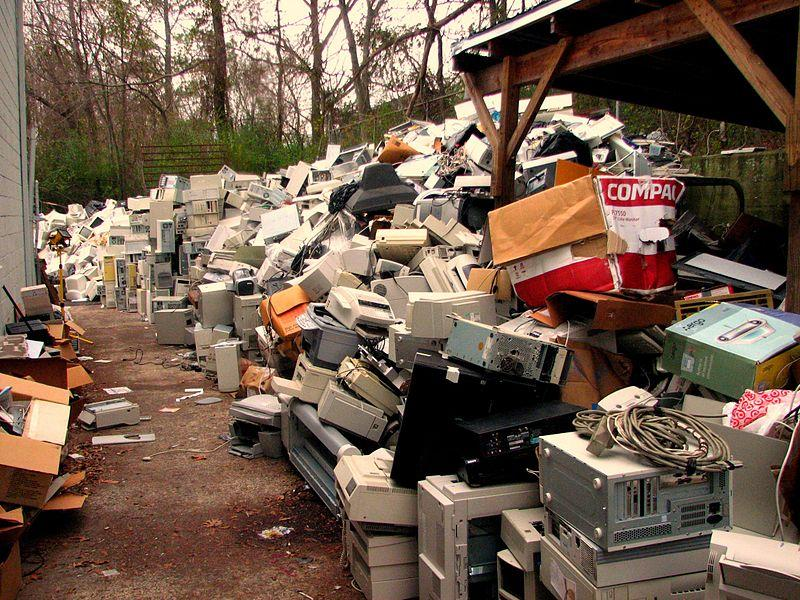 A pile of discarded computers and other electronics.
