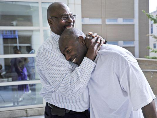 Robert Wilcoxson, right, is embraced by his father in 2011 after being proclaimed innocent in the murder of Walter Bowman. Wilcoxson now lives near Detroit.