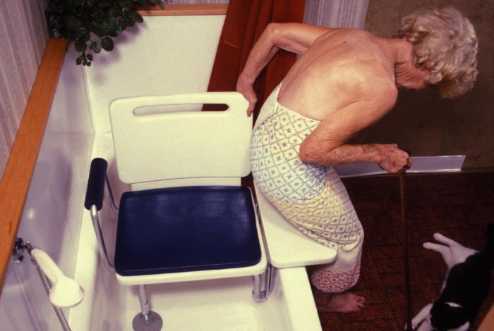 A picture of a woman with a bathtub balance seat.